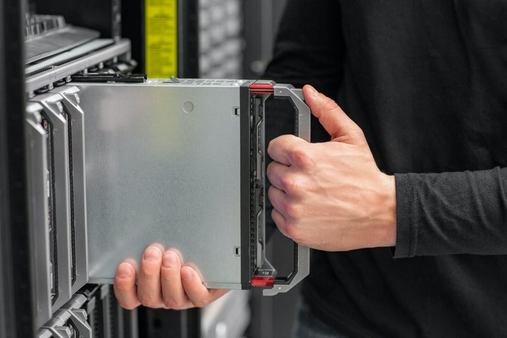 Close-up of IT consultant install blade Server in datacenter